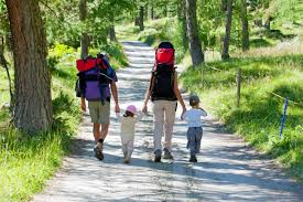 Family on a hike on country road