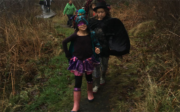 Families put on their capes and ventured into the woods