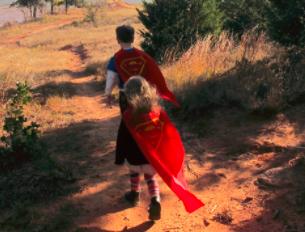 children in capes walking